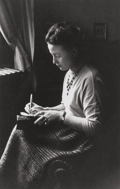 Simone de Beauvoir, the day of the Prix Goncourt, next to a window writing, Paris, 1954